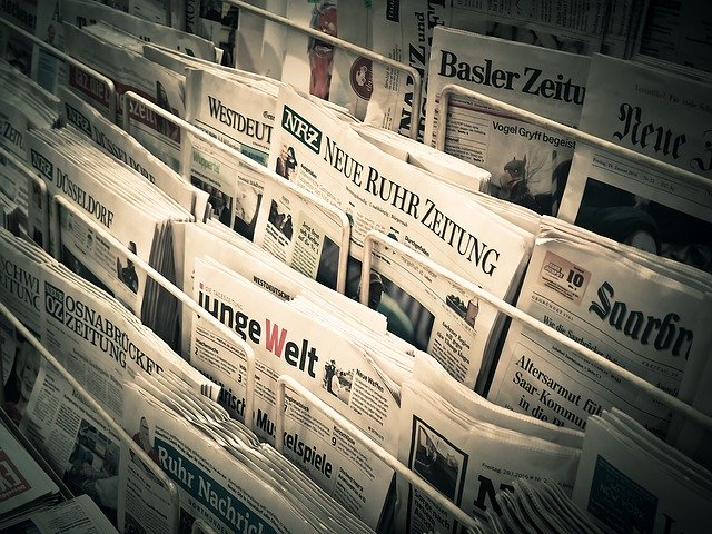 The picture is of a news stand and represents the many different types of niches (or topics) out there