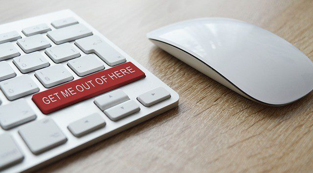 A keyboard that has button on it with the words 'GET ME OUT OF HERE'.